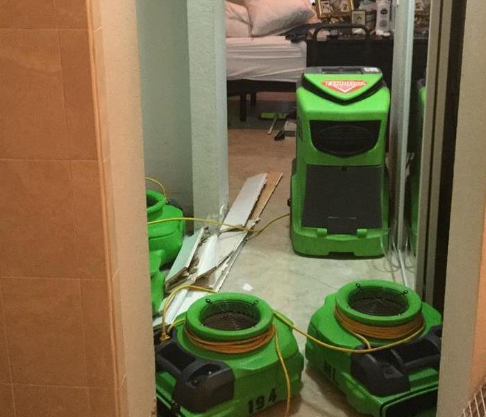 Hallway full of green air movers.