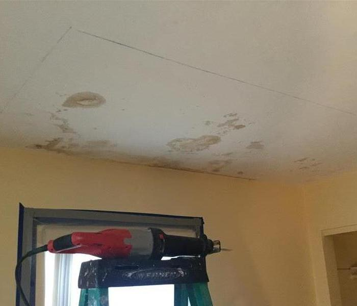 Water stained ceiling.