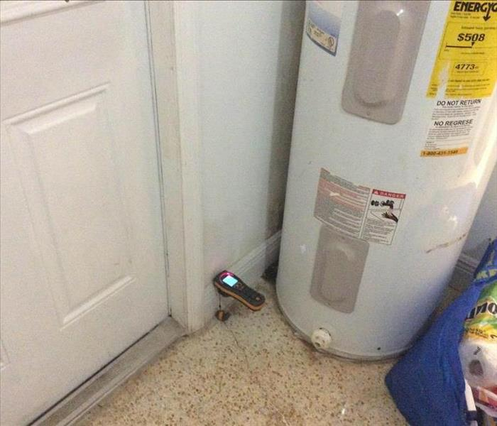 Water heater next to a moisture meter