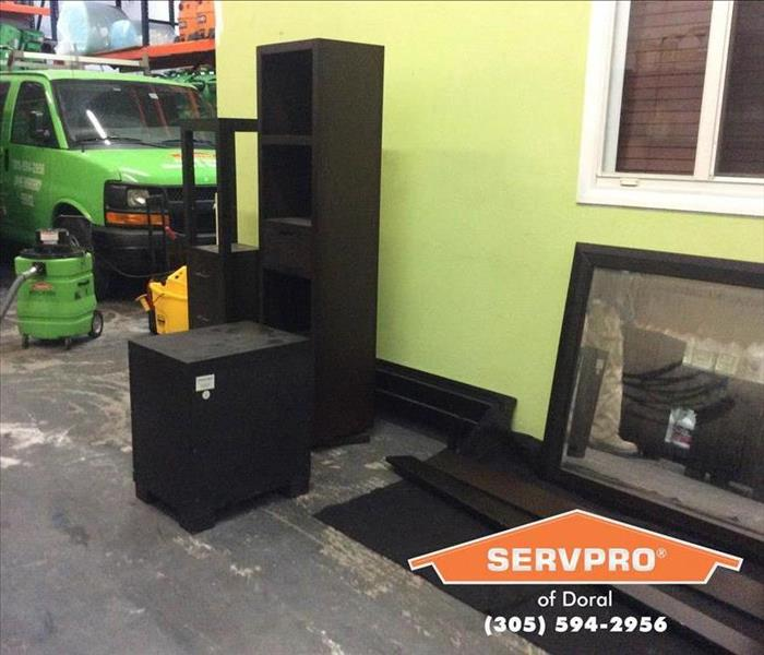 Two black shelves sitting inside a SERVPRO facility.
