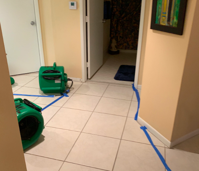 White tiled hallways with green air movers.