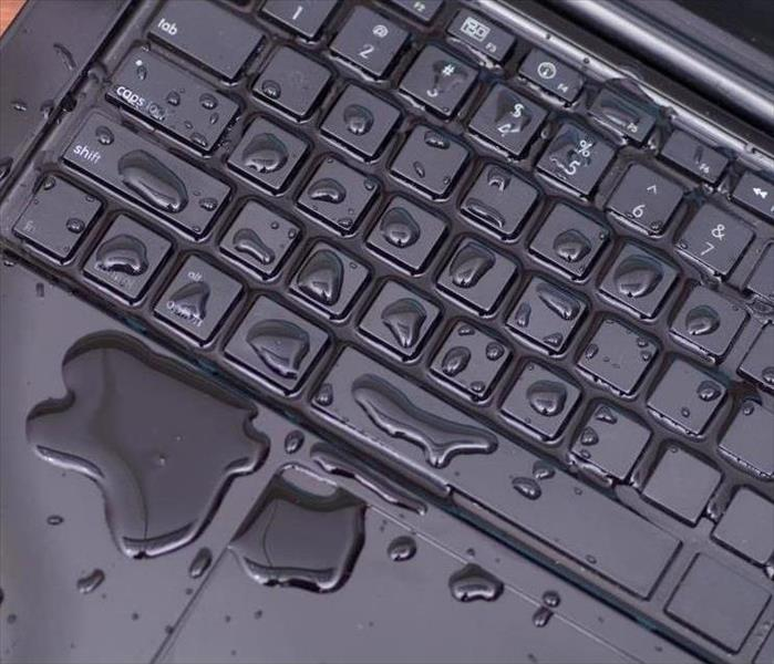 Water on keyboard of laptop